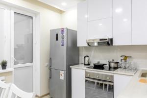 Кухня или мини-кухня в Prego Apartments in Vremena Goda