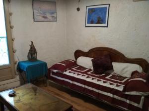 Un ou plusieurs lits dans un hébergement de l'établissement La P'tite Maison