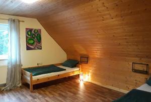 Ein Bett oder Betten in einem Zimmer der Unterkunft Ferienwohnung Daniela