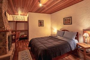 Cama ou camas em um quarto em Pousada Tom's Avenue