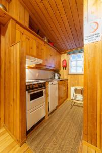 A kitchen or kitchenette at Apartments Kuukkeli Tokka