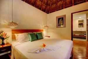 Cama o camas de una habitación en Riviera Maya Suites