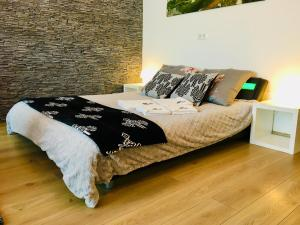 Łóżko lub łóżka w pokoju w obiekcie Na Przełaj - Apartament Zakopane