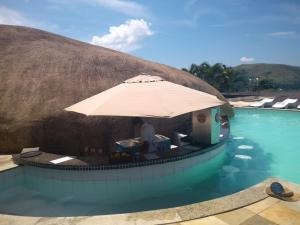 The swimming pool at or near Flat Angra Portogalo