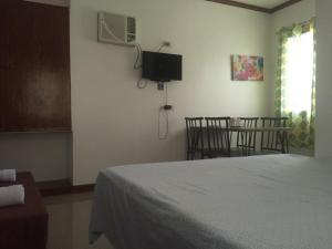 A bed or beds in a room at Ameeza House