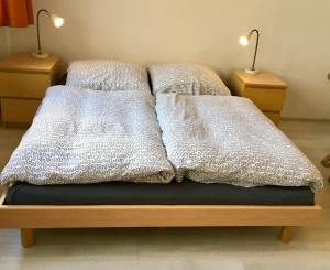 A bed or beds in a room at Apartment City West