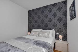 Krevet ili kreveti u jedinici u objektu Emilia Lofts