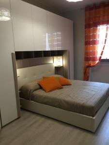A bed or beds in a room at De Angeli Luxury Flat