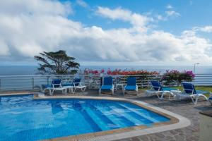 The swimming pool at or near Apartments Madeira