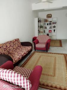 A seating area at BaitunNajah Homestay