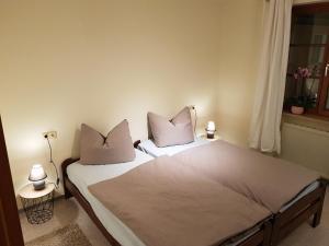 Ein Bett oder Betten in einem Zimmer der Unterkunft fewofelix