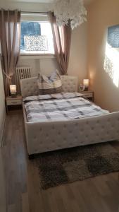 Ein Bett oder Betten in einem Zimmer der Unterkunft Apartment Helios