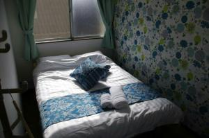A bed or beds in a room at OFA'S house