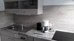 A kitchen or kitchenette at Haus Wald-Eck