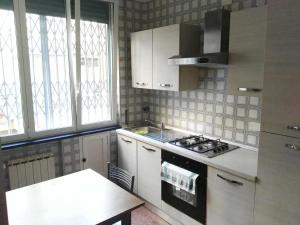 A kitchen or kitchenette at Genova Apartments