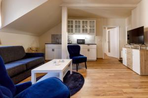 Posezení v ubytování Apartments Menuet