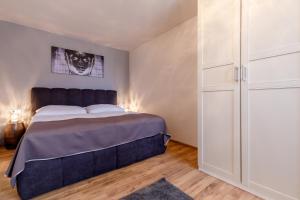 Postel nebo postele na pokoji v ubytování Apartments Menuet