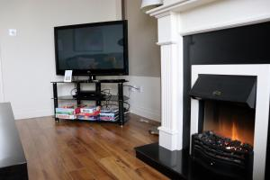 A television and/or entertainment center at Killarney Holiday Village