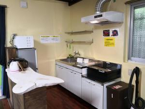 A kitchen or kitchenette at SATO