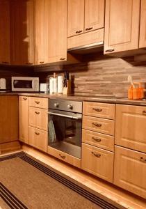 A kitchen or kitchenette at Mannimaatila LUX
