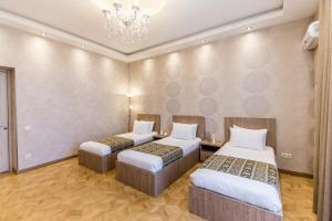 A bed or beds in a room at Apartment Dat Exx on the Marjanishvili
