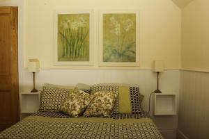 A bed or beds in a room at Blackrock House
