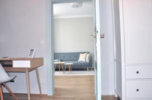 Ein Bett oder Betten in einem Zimmer der Unterkunft MINT Apartment