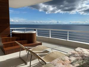 A balcony or terrace at Flat Varanda Rio Negro