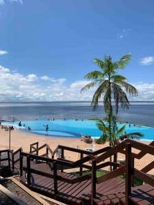 The swimming pool at or near Flat Varanda Rio Negro