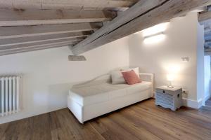 Een bed of bedden in een kamer bij Mattonaia Apartment