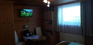 A television and/or entertainment center at Haus Fichtenblick