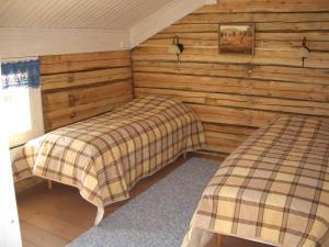 Vuode tai vuoteita majoituspaikassa Kalliomajat