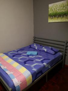 A bed or beds in a room at My Beauty Homestay