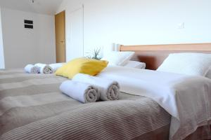 A bed or beds in a room at Success Luxury Accommodation