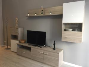 A television and/or entertainment center at De Angeli Luxury Flat