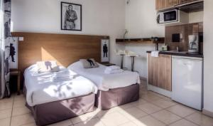Un ou plusieurs lits dans un hébergement de l'établissement Zenitude Hôtel-Résidences Le Maestria