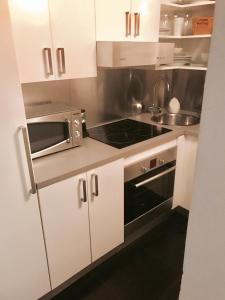 A kitchen or kitchenette at Chueca - Barbieri Corazón de Madrid