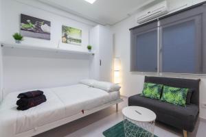 Säng eller sängar i ett rum på Rentalis Gran Via Fuencarral