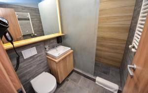 A bathroom at Grand Accommodation Apartments