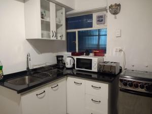 Una cocina o zona de cocina en Plaza Huelen