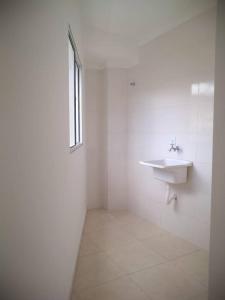 A bathroom at Apt de Temporada Mobiliado (sem moradores)