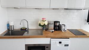 A kitchen or kitchenette at LE RELAIS D'ANJOU