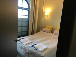 Łóżko lub łóżka w pokoju w obiekcie Apartamenty Platinum Loft