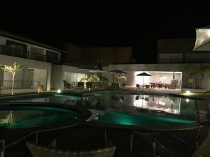 A piscina localizada em Condomínio Solaris Imbassai ou nos arredores