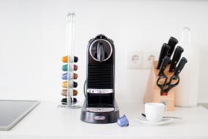 Coffee and tea-making facilities at The Flats Apartments - Urania