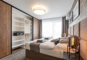 Posteľ alebo postele v izbe v ubytovaní Premium Apartments