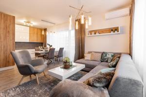 Posedenie v ubytovaní Premium Apartments