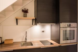 A kitchen or kitchenette at Maya Apartments - Thorvald Meyers gt. 38