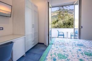 Кровать или кровати в номере Casa Vacanze Parco Del Generale