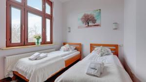 Letto o letti in una camera di Dom & House - Apartment Haffnera Supreme Sopot